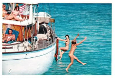JFK in a boat full of naked women.