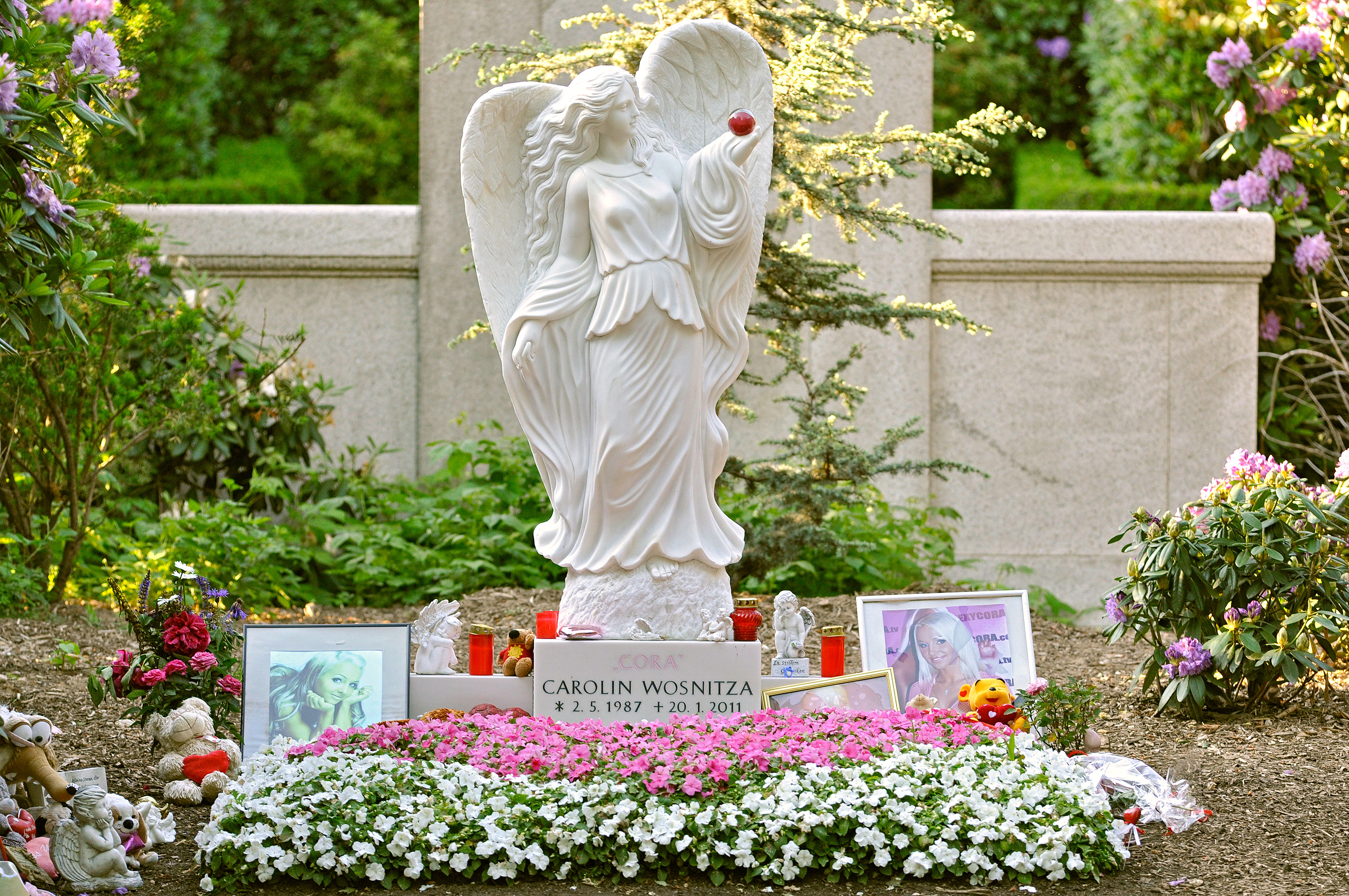 """Cora was buried in a pink coffin at Hamburg's Ohlsdorf Cemetery on 2 February 2011. In May 2011, however, cemetery officials demanded that her husband remove a four-feet tall marble angel and memorial photos that marked the grave, claiming the $15,000 installation was """"too sexy"""".[13] They argued that the grave's markings were inappropriate and could be deemed """"offensive by other mourners visiting the cemetery,"""" one of the largest in the world."""